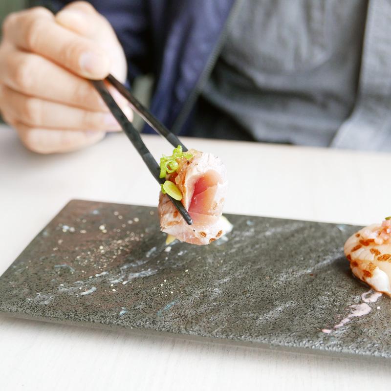Aburi Sashimi: trio selection of flame seared salmon, scallop and tuna with signature sauces.