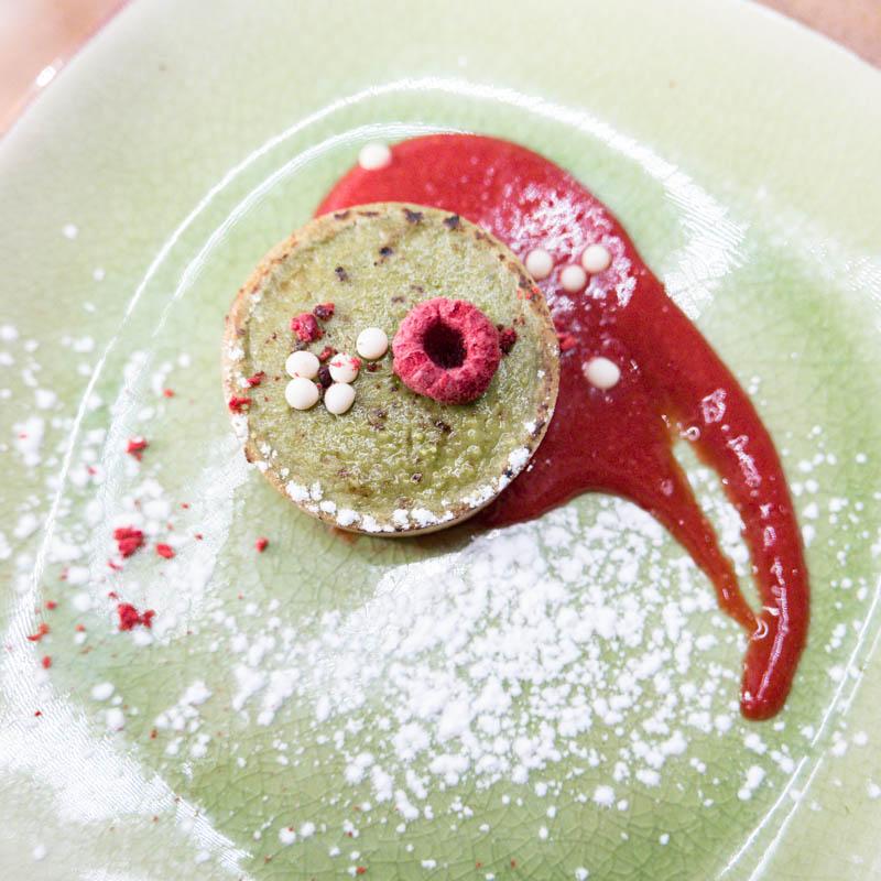 Matcha green tea cheese tart, raspberry coulis, crispy white chocolate pearls.