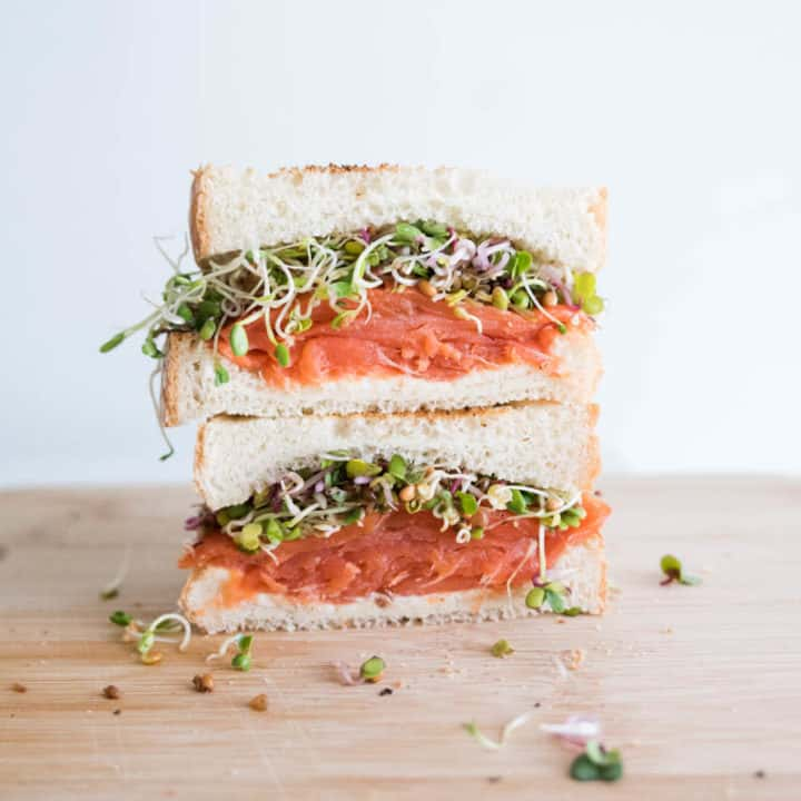 smoked salmon sandwich with alfalfa sprouts Nomss