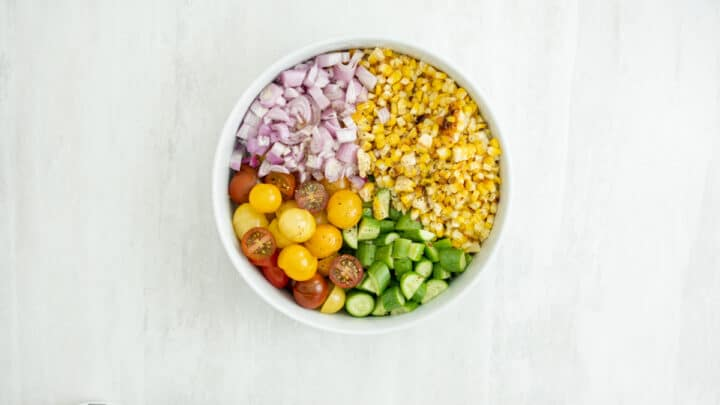 Cooking Corn in the air fryer is one of the simplest ways to indulge in Summer's sweet local corn on the cob. It is fantastic when you want to make this delicious quick and easy Air Fryer Simple Local Corn Summer Salad! #airfryercorn #cornrecipes #cobsofcorn#intheairfryer#onthecob#cornintheairfryer#frycorn #recipe #easyrecipe #localcorn#instanomss#andeasy #simplecornsaladrecipe